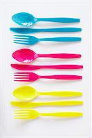 still life of three sets of colored plastic cutlery Stock Photo - Premium Rights-Managednull, Code: 700-06714094