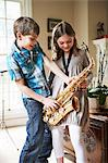 Children playing with saxophone Stock Photo - Premium Royalty-Free, Artist: Blend Images, Code: 649-06716493