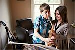 Children playing with saxophone Stock Photo - Premium Royalty-Free, Artist: Blend Images, Code: 649-06716495