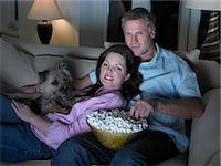 Couple watching movie together Stock Photo - Premium Royalty-Freenull, Code: 649-06716585