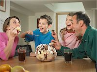 Family eating ice cream together Stock Photo - Premium Royalty-Freenull, Code: 649-06716588