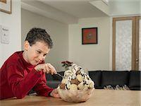 Boy eating large bowl of ice cream Stock Photo - Premium Royalty-Freenull, Code: 649-06716589