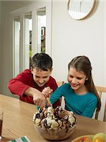 families eating ice cream - Children eating large bowl of ice cream Stock Photo - Premium Royalty-Freenull, C