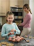 Mother and daughter baking together Stock Photo - Premium Royalty-Free, Artist: CulturaRM, Code: 649-06716595