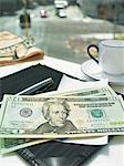 Money in check on restaurant table Stock Photo - Premium Royalty-Free, Artist: Blend Images, Code: 649-06716597
