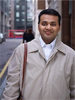 east indian (male) - Businessman standing on city street Stock Photo - Premium Royalty-Freenull, Code: 649-06716601