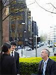 Business people talking on city street Stock Photo - Premium Royalty-Free, Artist: Cultura RM, Code: 649-06716615