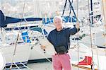 Older man standing on boat Stock Photo - Premium Royalty-Free, Artist: Westend61, Code: 649-06716681