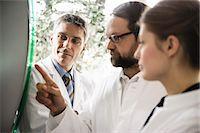 Doctors using glass panel Stock Photo - Premium Royalty-Freenull, Code: 649-06716728