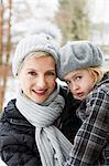 Mother carrying daughter in snow Stock Photo - Premium Royalty-Freenull, Code: 649-06716794