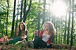 Teenage girls having picnic in forest Stock Photo - Premium Royalty-Free, Artist: Blend Images, Code: 649-06716825