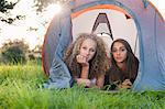 Teenage girls laying in tent at campsite Stock Photo - Premium Royalty-Free, Artist: ableimages, Code: 649-06716846