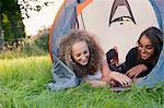 Teenage girls laying in tent at campsite Stock Photo - Premium Royalty-Free, Artist: Cultura RM, Code: 649-06716847