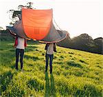 Teenage girls pitching tent in field Stock Photo - Premium Royalty-Free, Artist: ableimages, Code: 649-06716859
