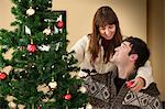 Couple decorating Christmas tree Stock Photo - Premium Royalty-Free, Artist: Blend Images, Code: 649-06716861