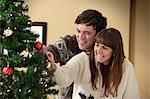 Couple decorating Christmas tree Stock Photo - Premium Royalty-Free, Artist: Beanstock Images, Code: 649-06716862