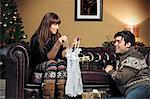 Couple opening Christmas presents Stock Photo - Premium Royalty-Free, Artist: CulturaRM, Code: 649-06716865