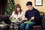 Couple eating salad on sofa Stock Photo - Premium Royalty-Free, Artist: urbanlip.com, Code: 649-06716873