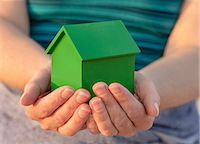 Hands holding model house outdoors Stock Photo - Premium Royalty-Freenull, Code: 649-06716903