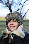 Woman wearing fur hat outdoors Stock Photo - Premium Royalty-Free, Artist: ableimages, Code: 649-06716927