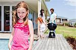 Girl smiling on backyard patio Stock Photo - Premium Royalty-Freenull, Code: 649-06716987