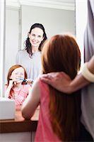 Mother watching daughter brush teeth Stock Photo - Premium Royalty-Freenull, Code: 649-06716993