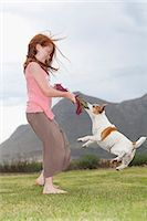 red hair preteen girl - Girl playing with dog in grass Stock Photo - Premium Royalty-Freenull, Code: 649-06717007
