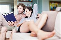 Couple relaxing together on sofa Stock Photo - Premium Royalty-Freenull, Code: 649-06717023