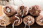 Close up of wrapped cured meat Stock Photo - Premium Royalty-Free, Artist: Cultura RM, Code: 649-06717147