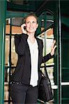 Businesswoman talking on cell phone Stock Photo - Premium Royalty-Free, Artist: Blend Images, Code: 649-06717159