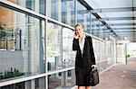 Businesswoman talking on cell phone Stock Photo - Premium Royalty-Free, Artist: Michael Mahovlich, Code: 649-06717182