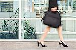 Businesswoman walking on city street Stock Photo - Premium Royalty-Freenull, Code: 649-06717185