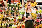 Grocer working in florist section Stock Photo - Premium Royalty-Free, Artist: Blend Images, Code: 649-06717200