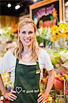 Grocer smiling in florist section Stock Photo - Premium Royalty-Free, Artist: Ikonica, Code: 649-06717201