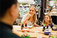 family table eating together - Mother and daughter eating at deli Stock Photo - Premium Royalty-Freenull, Code: 649-06717213