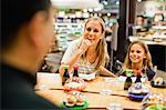 Mother and daughter eating at deli Stock Photo - Premium Royalty-Free, Artist: Westend61, Code: 649-06717213