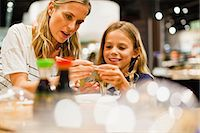 family table eating together - Mother and daughter using chopsticks Stock Photo - Premium Royalty-Freenull, Code: 649-06717214