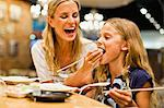 Mother and daughter using chopsticks Stock Photo - Premium Royalty-Free, Artist: Blend Images, Code: 649-06717215