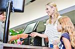 Mother and daughter in grocery store Stock Photo - Premium Royalty-Free, Artist: Blend Images, Code: 649-06717230
