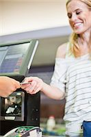 Woman paying with credit card in store Stock Photo - Premium Royalty-Freenull, Code: 649-06717231