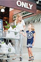 Mother and daughter with groceries Stock Photo - Premium Royalty-Freenull, Code: 649-06717233