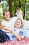 Couple relaxing on blanket in park Stock Photo - Premium Royalty-Free, Artist: Jim Craigmyle, Code: 649-06717237