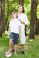 Father and son smiling in park Stock Photo - Premium Royalty-Freenull, Code: 649-06717243