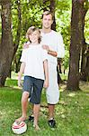 Father and son smiling in park Stock Photo - Premium Royalty-Free, Artist: Blend Images, Code: 649-06717243