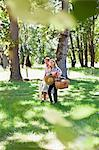 Couple walking in park Stock Photo - Premium Royalty-Free, Artist: ableimages, Code: 649-06717245
