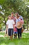Family with picnic basket in park Stock Photo - Premium Royalty-Free, Artist: Blend Images, Code: 649-06717249