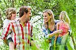 Family walking together in park Stock Photo - Premium Royalty-Free, Artist: Jim Craigmyle, Code: 649-06717260
