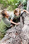 Father helping son over fallen tree Stock Photo - Premium Royalty-Free, Artist: Robert Harding Images, Code: 649-06717266
