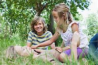 Mother and children playing in park Stock Photo - Premium Royalty-Freenull, Code: 649-06717274