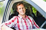 Smiling man sitting in car Stock Photo - Premium Royalty-Free, Artist: Robert Harding Images, Code: 649-06717275